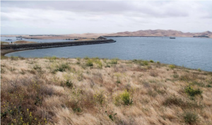 Image depicting the crest of dam impounding San Luis Reservoir.